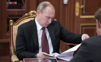 Vladimir Putin meeting Minister of Industry and Trade Denis Manturov.