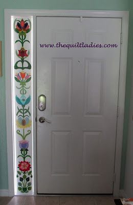 Adding painted flowers to doorway glass pattern