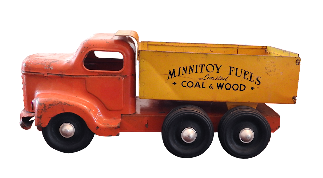 An Otaco minnitoy dump truck with the coal and wood logo, made in Orillia, Ontario.