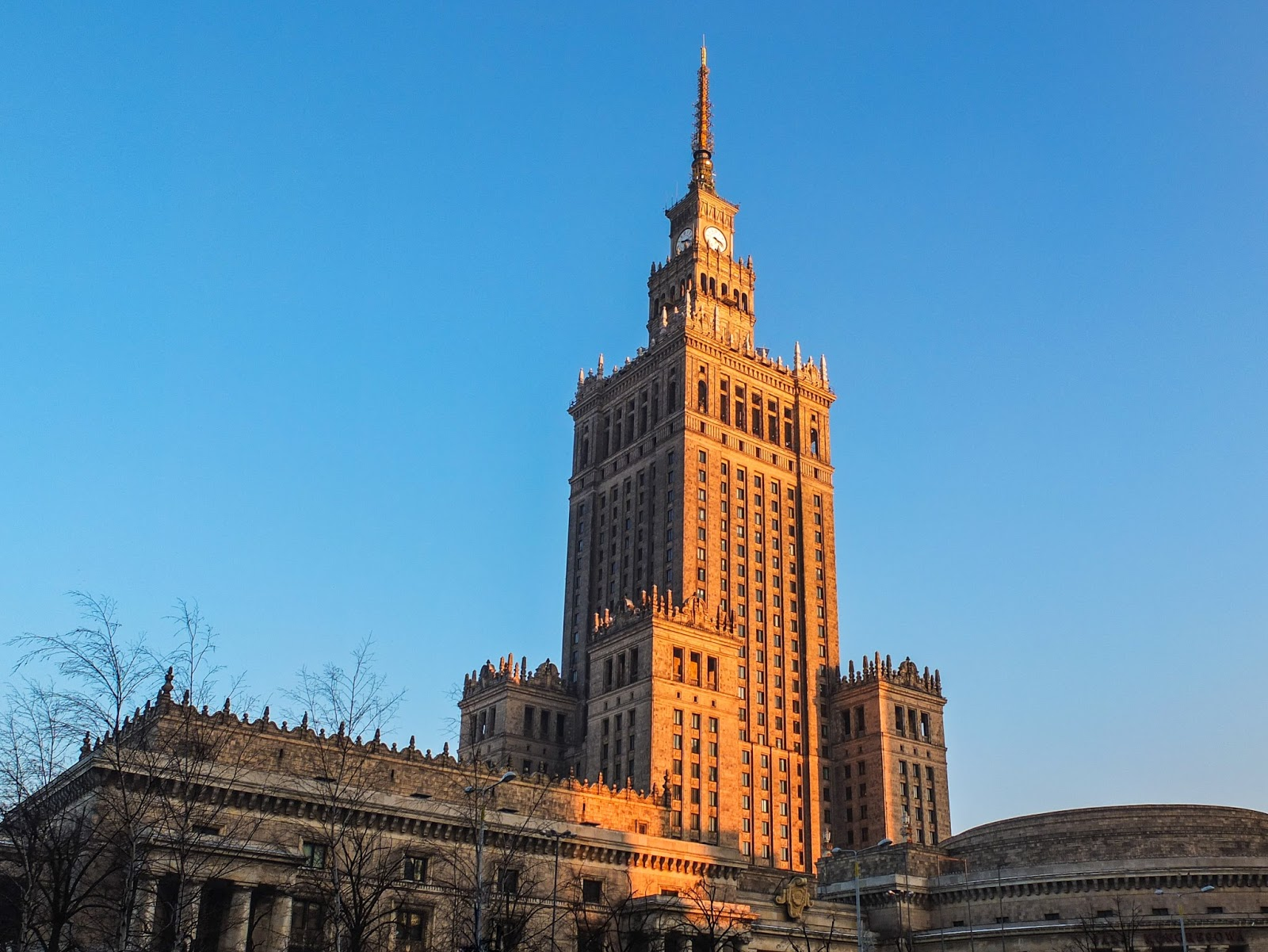 Palace of Culture and Science in Warsaw, Poland at sunset.