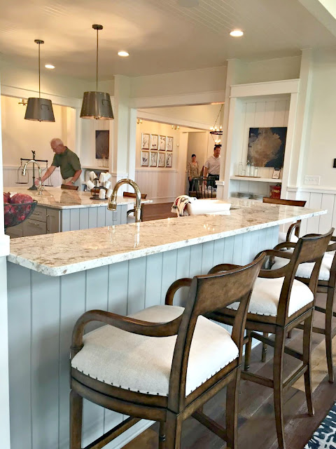 breakfast bar with chairs in kitchen