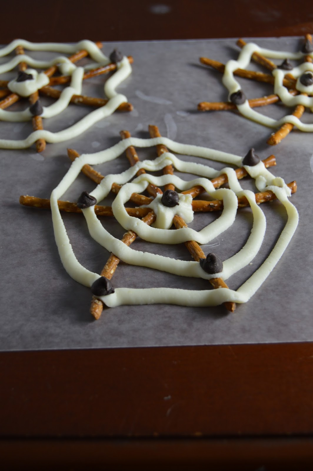White Chocolate and Pretzel Spider Webs | A Taste of Madness