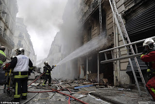 Huge explosion rocks Paris Street - as firefighters rush to the scene