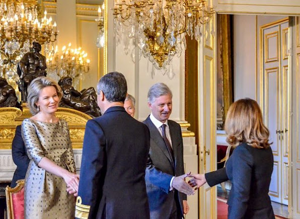 Queen Mathilde and King Philippe attended the New Year's reception organized by the Royal Family. Queen wore natan dress, Natan Coat