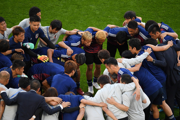 The Japan players form a team huddle prior to the 2018 FIFA World Cup Russia group H match between Japan and Senegal at Ekaterinburg Arena on June 24, 2018 in Yekaterinburg, Russia.