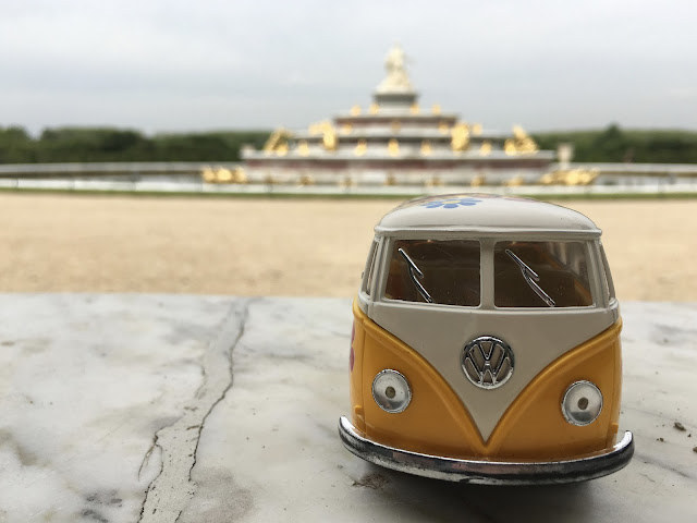 Yellow Van with fountain at the gardens of Versailles