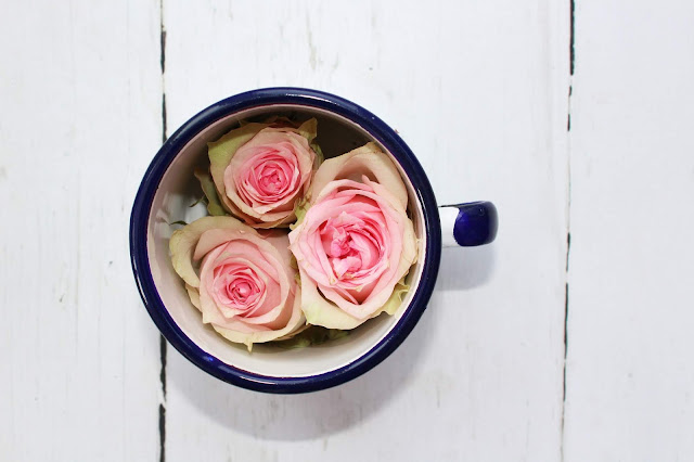 Roses in a tin cup