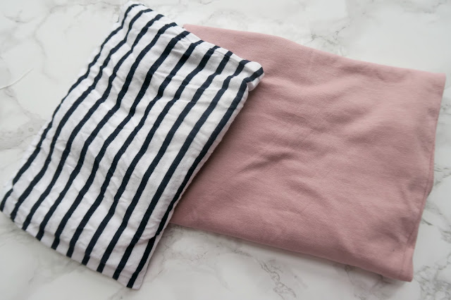 Black and white stripy t-shirt and a light pink t-shirt