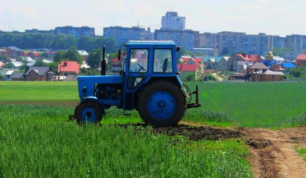 Tractor on the field behind the town