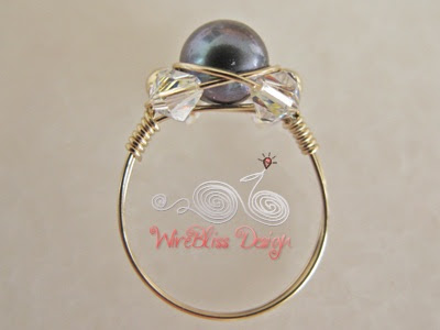 wire wrapped sparkly ring with pearl