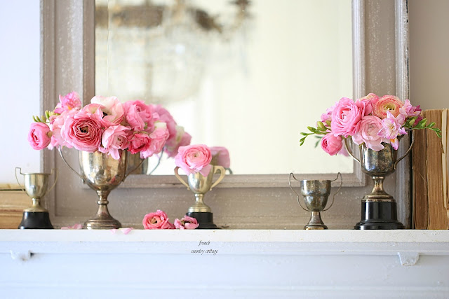 mantel styling with vintage silver trophies and ranunculus