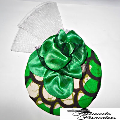Green African print saucer fascinator