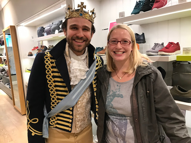 A photo of me grinning next to a prince in formal attire and crown claiming to be charming
