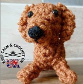 http://www.ravelry.com/patterns/library/teeny-tiny-daschund-amigurumi