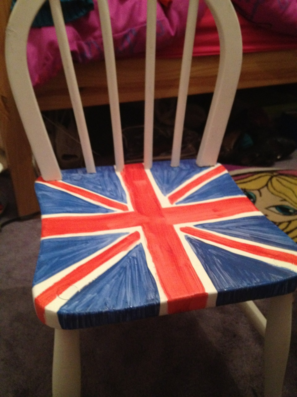 A white wooden chair with the union jack on the seat.