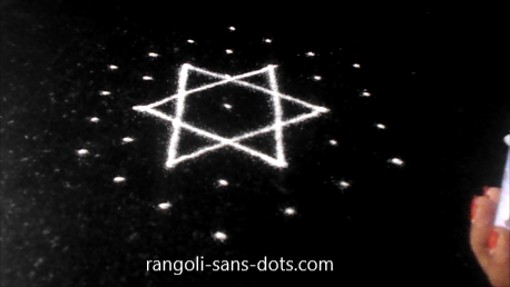 dotted-rangoli-in-black-background-272a.jpg
