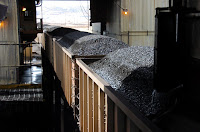 In this April 4, 2013 photo, coal is loaded onto hopper cars at the Spring Creek Mine near Decker, Mont. At least 30 applications from companies seeking to mine hundreds of millions of tons of coal face suspension as the government reviews its sales of the fuel from public lands, U.S. officials disclosed Friday, Jan. 15, 2016. (Photo Credit: AP/Matthew Brown) Click to Enlarge.
