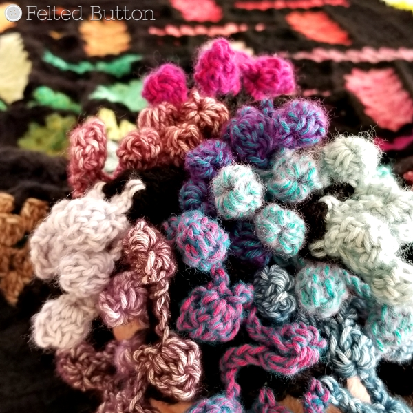 Pom Pom Edging on Warp and Weft Blanket {Free Crochet Pattern} by Susan Carlson of Felted Button