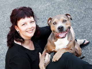 Ruth O'Leary pet photographer with one of her smiling rescue dogs