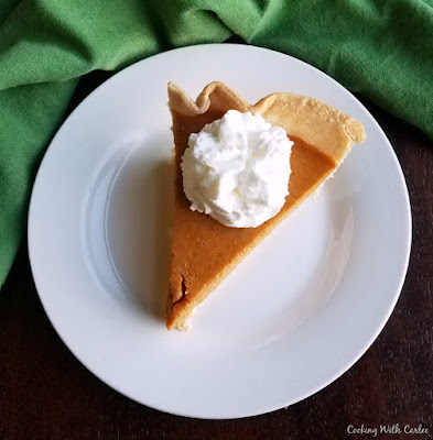 slice of maple pumpkin pie with whipped cream