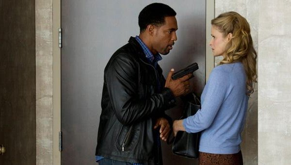 The Closer - Marvin Evans (Jason George) points gun at Chief Johnson (Kyra Sedgwick)