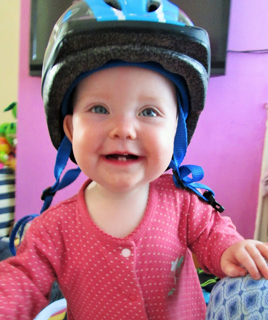 Baby S smiling at the camera with a child's blue bike helmet on her head - My Sunday photo