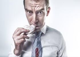 A man eating a cookie.