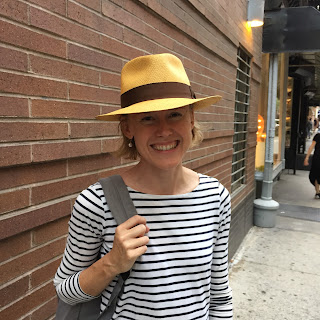 Young woman in a Panama Hat at The Hat House in SoHo NY
