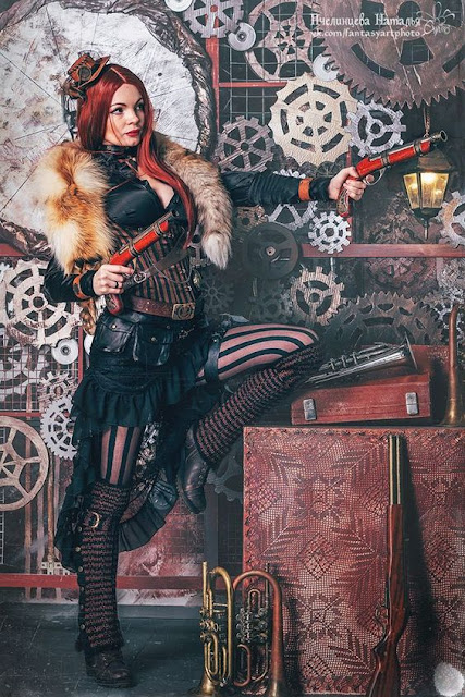 Steampunk redhead female wearing striped corset and stockings, skirt, blouse and fur wrap
