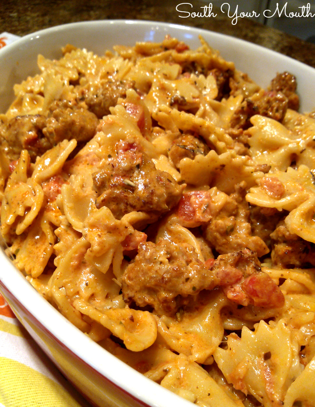 Italian Sausage and Pasta with Tomato Cream Sauce! A quick and easy creamy pasta dish with Italian sausage, cream, tomatoes and parmesan cheese.