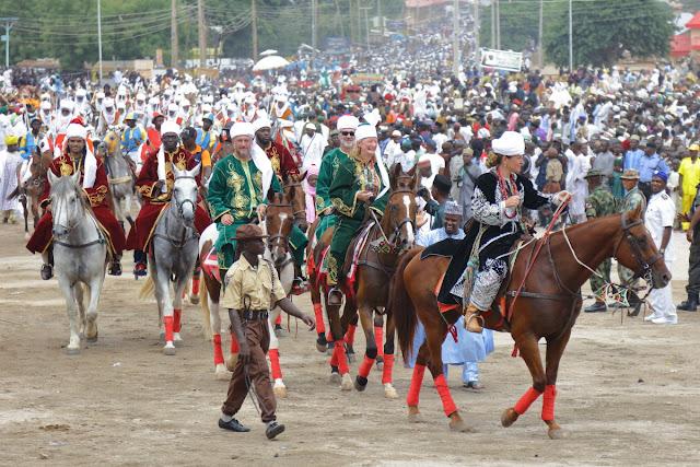 a delegation of ambassadors riding at the Durbar