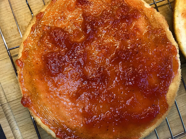 A layer of sponge cake covered in jam