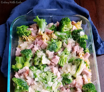 ham and broccoli layerd over pasta in dish