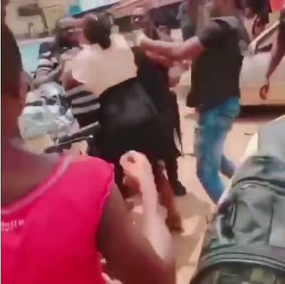 Nigerian Police Officers Manhandle and Beat Up A Woman In Cross Rivers State
