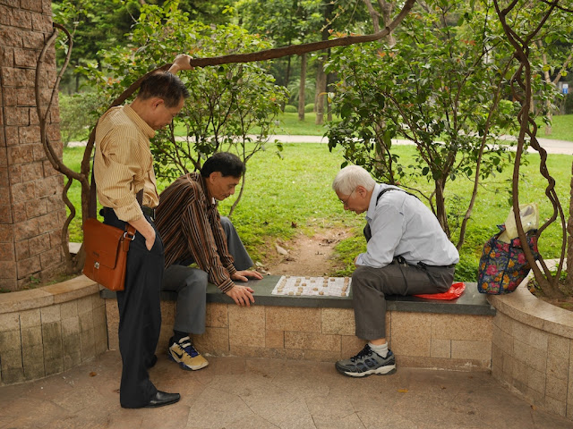 two men playing xiangqi at he Lin Zexu Memorial Park in Guangzhou