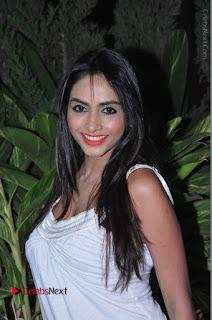 Actress Model Pooja Sri Stills in White Short Dress at F Club pre soft Launch  0008.JPG