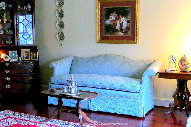 Damask sofa and antiques in the living room.