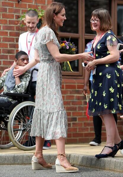 Kate Middleton is wearing a print floral summery midi dress, Castaner wedges and her Catherine Zoraida earrings