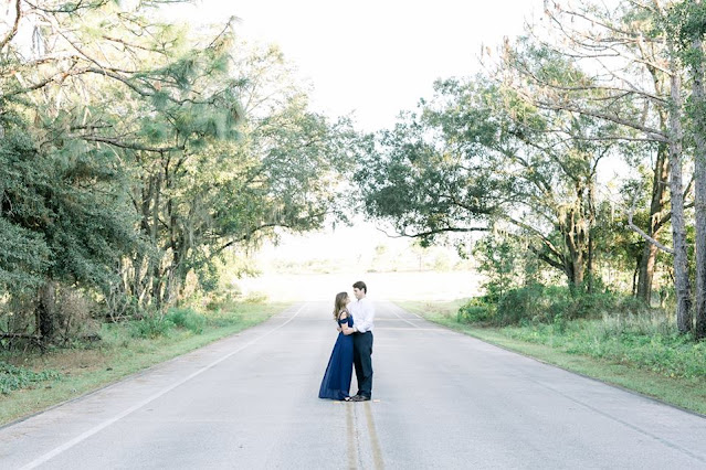 couple gazing at each other in middle of road