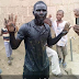 Man immerses himself in gutter to celebrate President Muhammadu Buhari's re-election