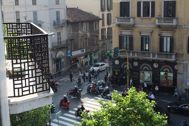 Vespas viewed from balcony in Milan