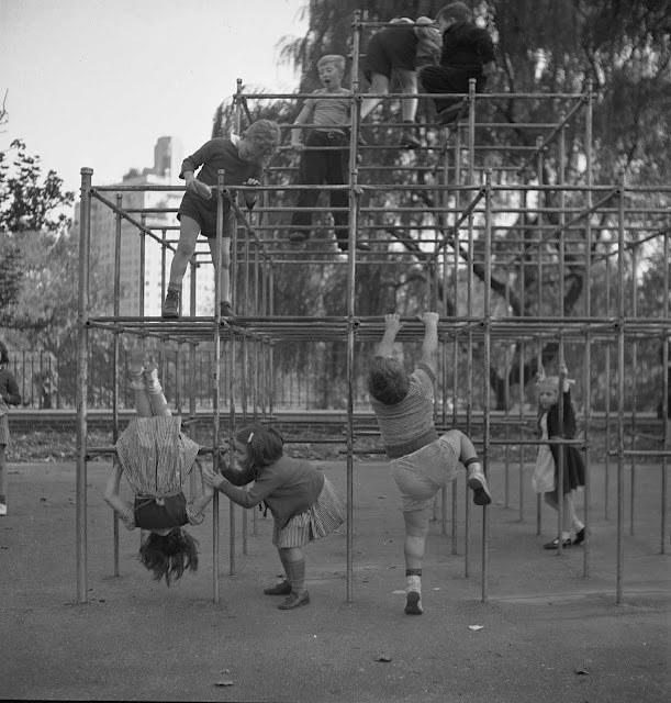 Czech-American children, climbing on monkey bars in Central Park playground.