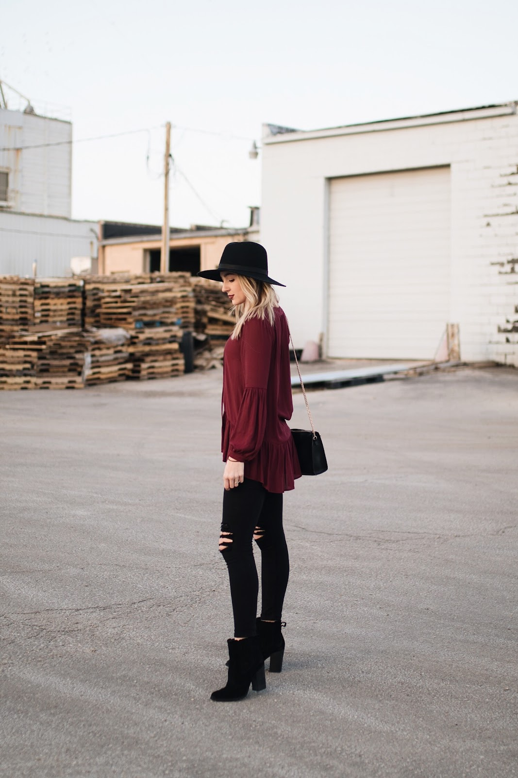 burgundy top, black jeans and ankle boots
