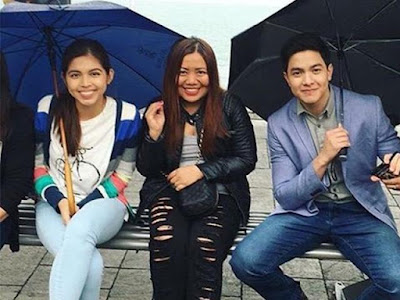 Alden and Maine with a fan from Italy