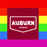 The logo of Auburn, Indiana superimposed on a gay lgbt lgbtq rainbow flag