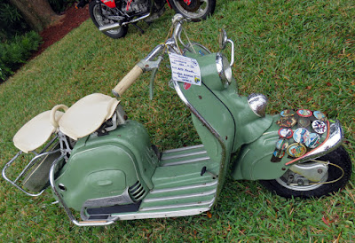 Pastel green motor scooter.