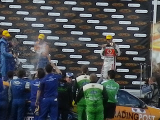 V8 SUPERCARS CHALLENGE WINNERS CELEBRATING WITH CHAMPAGNE