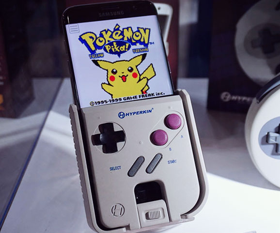 The Hyperkin Smartboy turns your Android phone into a full-fledged Game Boy that you can play while you're on the go. It features a double-sided USB port, classic handheld-style tactile buttons, and is compatible with both Game Boy and Game Boy Color cartridges.