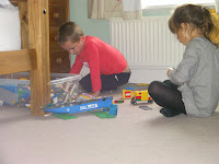 girl in tights playing lego builder
