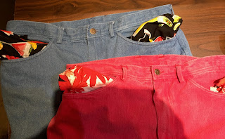 Light blue and red jeans with printed pockets turn out.